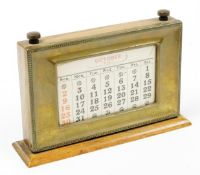 A 1930's oak and silver plated desk calendar, of rectangular form, with articulated paper