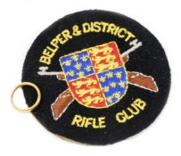 A 22ct gold wedding band, size J-K, 6.3g, and a Belper & District Rifle Club iron on badge. (2)