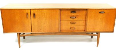 A G-Plan 1950's/1960's teak sideboard, with single cupboard, four drawers and double cupboard, on