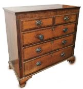An early 19thC oak and marquetry chest, of two short and three long drawers, each drawer with