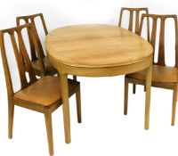 A Nathan ash and elm dining suite, comprising an oval extending dining table, and four matching