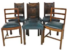 A set of late 19thC oak dining chairs, each with shield carved back, on blue faux leather seats,