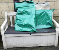 A garden storage bench, folding camping chairs, etc.