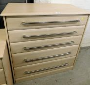A modern chest of five drawers, with three shallow and two deep drawers, with wood finish, and