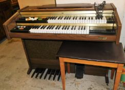 A Hohner Symphonie D92 electric organ, with stool.