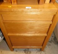 A modern oak filing drawer, comprising three drawer design, with file tray insert to bottom