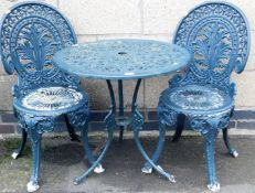 A metal two piece garden bistro set, painted in green.
