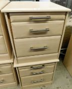 A pair of modern bedside cabinets, with wood finish, each with graduated drawers, with steel