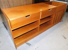 A modern teak finish TV stand or sideboard, configured with open box top, and shelf to one side, two