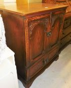 An oak Old Charm TV cabinet, with cupboard top and single drawer to base, 92cm high, 77cm wide, 49cm