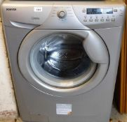 A Hoover Optima washing machine, in silver.