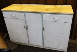 A painted kitchen dresser, of rectangular form, with yellow Melamine style top, raised above drawers