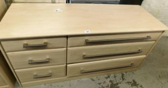 A modern chest of drawers, of three short and three long drawers, with wood finish top, with