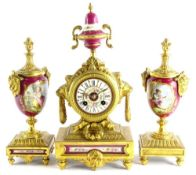 A late 19thC French gilt metal and porcelain clock garniture, the clock decorated with an urn