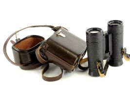 A pair of Carl Zeiss Dialyt 8x30 B binoculars, in a brown leather case, the binoculars 11.5cm high.