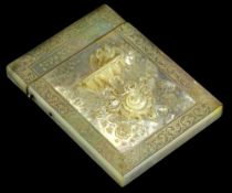 A Victorian carved mother of pearl card case, decorated in relief with a bird bath, scrolls,