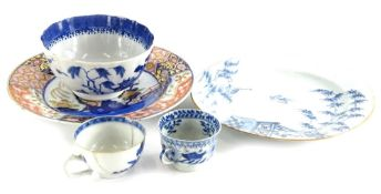 A Chinese export blue and white plate, decorated with geese, bamboo and a terrace, in blue within