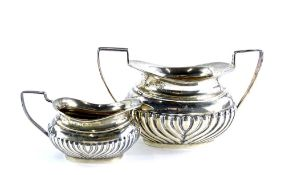 An Edwardian silver two handled sugar bowl, with part fluted decoration, Birmingham 1900, and a