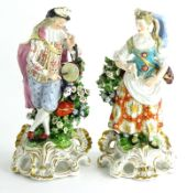 A pair of late 18thC Derby porcelain figures, each modelled in the form of a male and a female