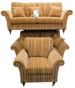 A Parker Knoll suite of furniture, each piece upholstered in striped fabric on turned legs with