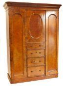 A Victorian walnut and burr walnut triple wardrobe, of small proportions, the top with a moulded