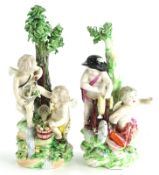 A pair of late 18thC Derby porcelain figures, each modelled in the form of putti with fish and knife