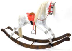 A dapple grey rocking horse, on shaped rocker, brass plaque for Made by John Marriott, Bromham,
