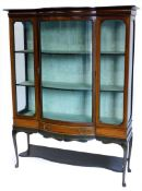 An Edwardian mahogany and checker banded display cabinet, with a shaped top, a bow fronted central