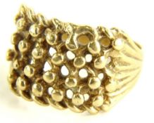 A 9ct gold knot ring, with four row knot design, ring size R, 5.8g all in.
