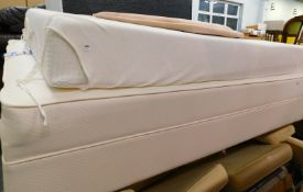 A single bed, comprising bed base, mattress, and a button back velour headboard.