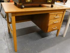 A lightwood desk, of rectangular form with three drawers, on square tapering legs joined by a H