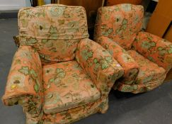 Two armchairs in floral material, 93cm wide, with serpentine backs, raised front seats and block