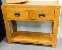 An oak two drawer side cabinet, with under tier.