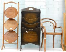 A mahogany three tier folding cake stand, an oak magazine rack, and a small childs bentwood chair,
