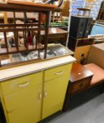 A vintage kitchen cabinet, of rectangular form, with yellow drawers and cupboards, 85cm high,
