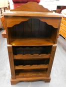A mahogany wine rack, with raised back and shelves for bottles etc.