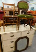 A white painted chest of two short and two long drawers, oak framed wall mirror, tripod table,