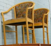 A pair of hotel or conference type chairs, stamped Made by IMS SRL.