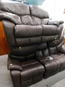A two piece electric reclining lounge suite, comprising three and two seater settees' in dark
