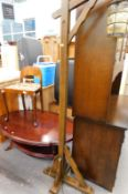 An Art Deco low back chair, oval topped occasional table, and an oak lantern standard lamp.