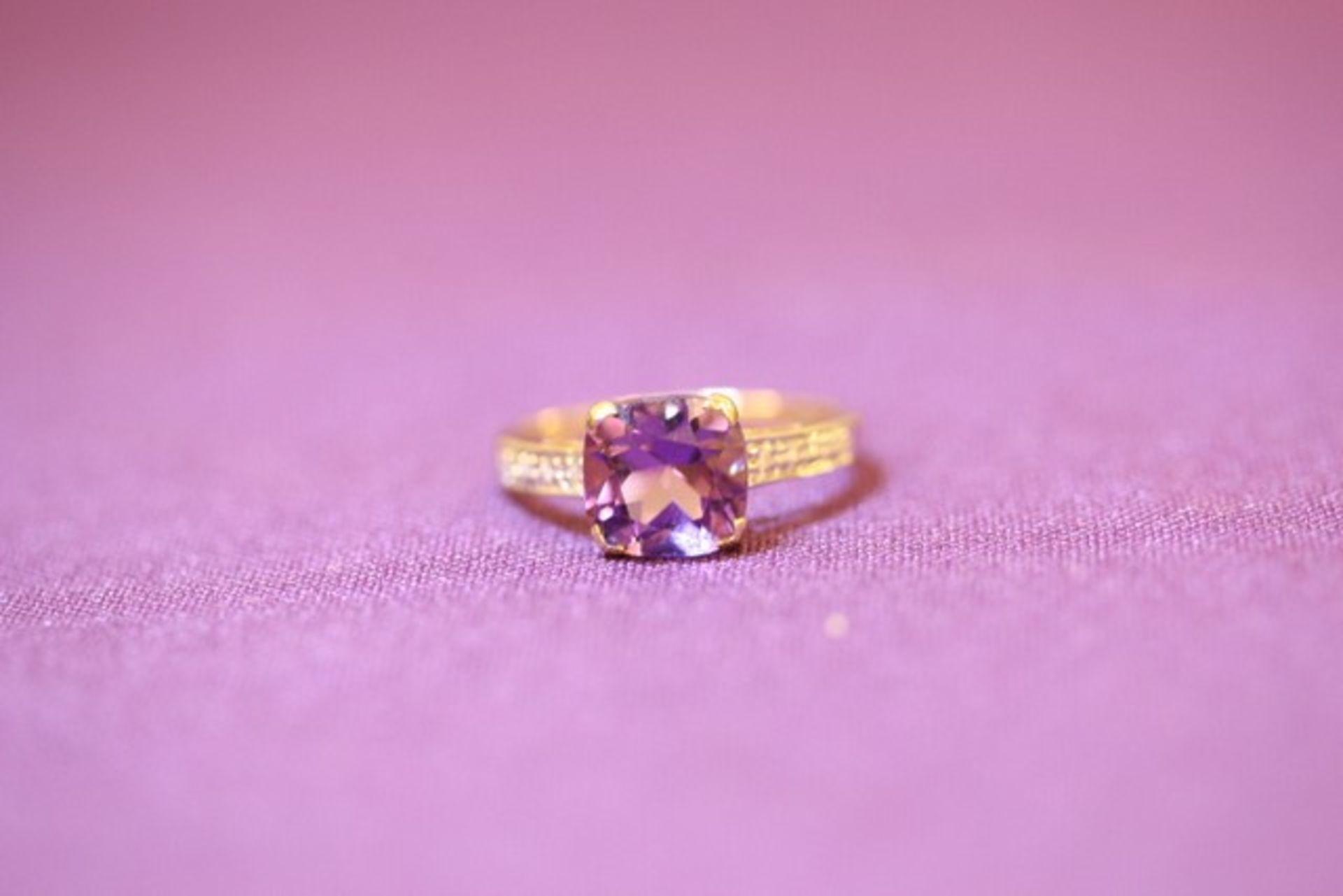 Lot 11565 - Brand New Yellow Gold Purple Topaz & Diamond Ring