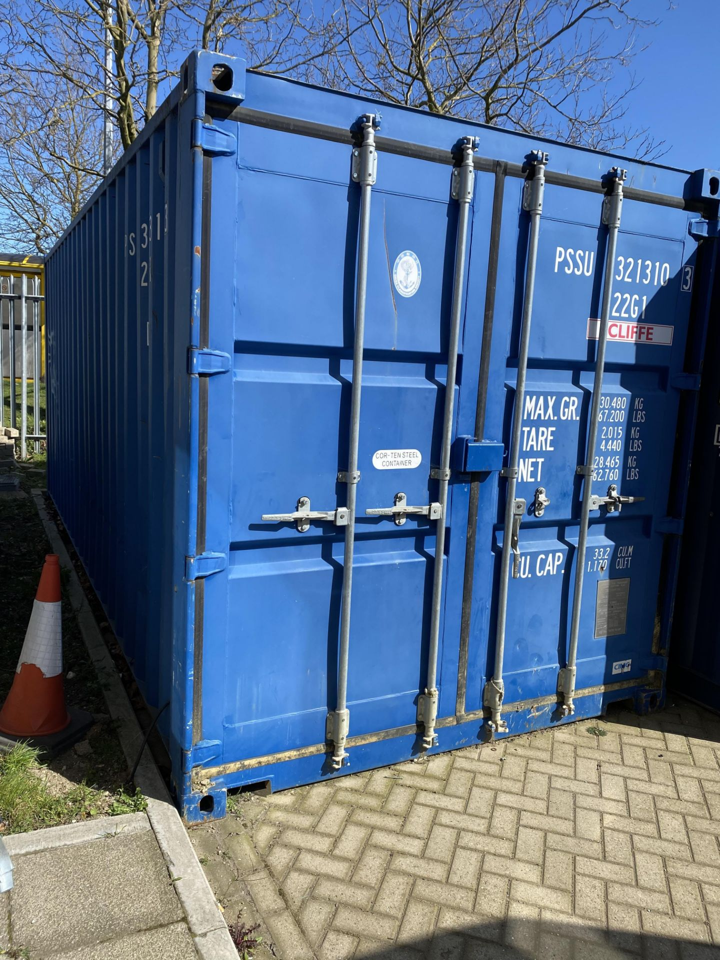 Lot 16 - 20' steel shipping container and contents of racking