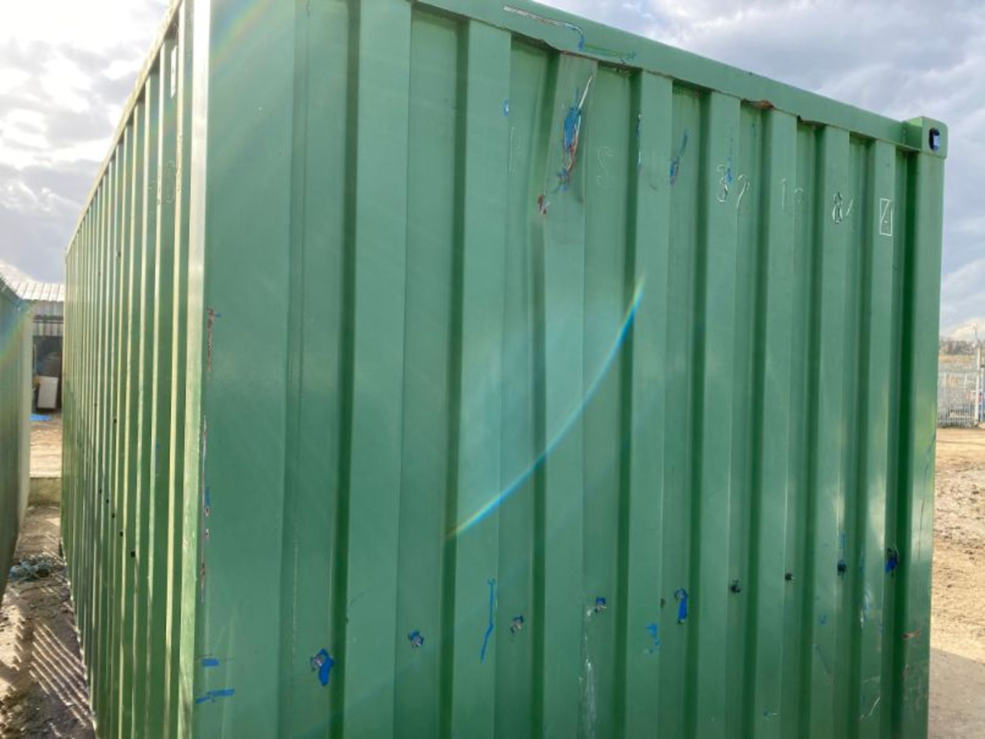 Lot 51 - 20' steel shipping container and contents as lotted