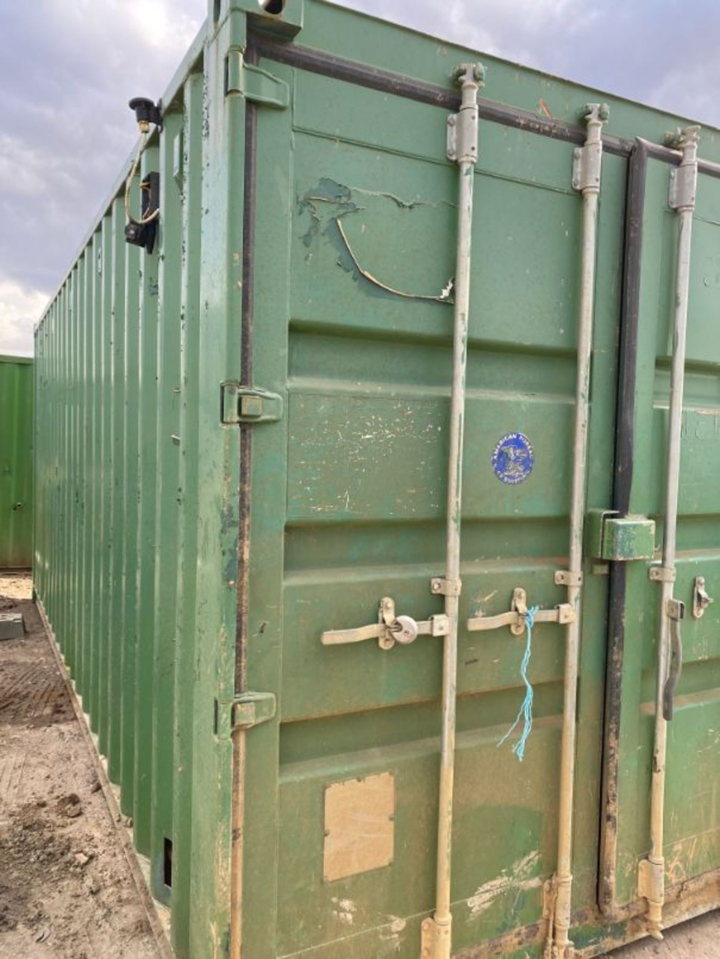 Lot 53 - 20' steel shipping container and contents as lotted