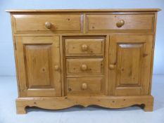 Pine sideboard unit with two cupboards and five drawers