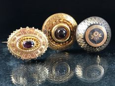 Two Mid-Victorian Gold coloured memorial brooches (one with Kite mark to reverse) set with Garnets