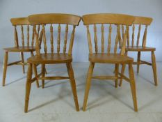 Set of four pine kitchen chairs with spindle backs