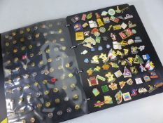 Large collection of pins and badges in album