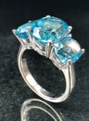 Silver and blue topaz three stone ring