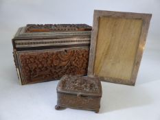 Carved tea caddy (A/F) and a small carved trinket box along with a silver picture frame